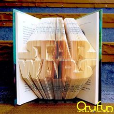 Intricately Folded Pages Transform Hardcover Books into Standing Sculptures www.mymodernmet.c...  #art