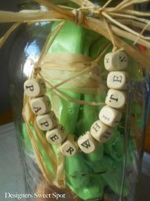 the gardener s mason jar gift, crafts, gardening, mason jars, I added the letters to some raffia and tied it around the top of the jar More on the blog