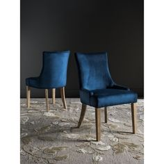 Inspired by the sinuous art deco curves of furnishings in a Parisian hotel, these contemporary dining chairs (set of 2) bring luxury to the table. Upholstered in a lush contemporary navy hue, these je