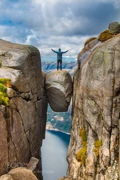 http://500px.com/photo/189753389 Kjeragbolten by MartinKrass -It was a majestic moment above a 984m (3.228 ft) deep abyss over the the Lysefjord after a fantastic hike.  Thats me on the Kjeragbolten. Photographed with my camera from a friend of mine.. Tags: skylandscapenaturetravelcloudsrockviewscandinaviamountainedgedramaticnorgesunbeamshikingepicadventurescenicabysswandernAbenteuerNorwayStavangerRogalandNorwegenLysefjordenLysefjordKjeragLysebotnKjeragboltenAbgrund