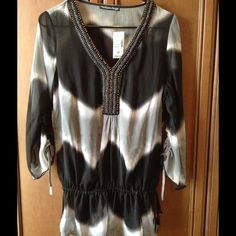 Fancy embellished top with built in black tank top Brand new, never worn, tags still on. Super adorable, embellishment around the neck line. Has an attached black tank/cami underneath. Always from a smoke free home. Tops