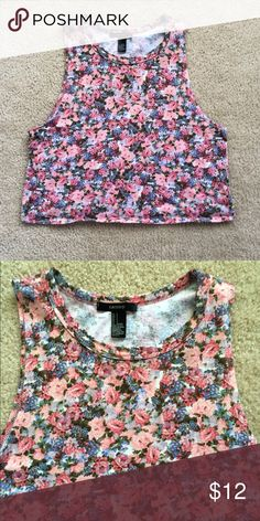 high neck floral crop top High neck sleeveless crop top with adorable floral pattern. Size small, but fits big more like a medium. Perfect condition Forever 21 Tops Crop Tops