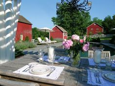 I love the table setting and small red barns: English-Inspired Connecticut Garden - Traditional Home®