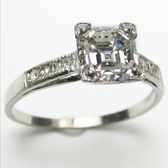 Asscher Stunner: For asscher lovers, it doesn't get much better than this.  A beautiful 1.25ct asscher cut of exceptional whiteness and clarity perches above a refined and elegant platinum mounting.  Ca.1930.  Maloys.com