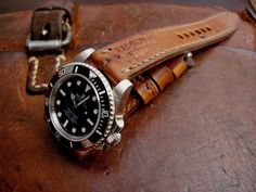 (Click on any photo to enlarge) Hi strap lovers, here is a recently completed 1964 Swiss Ammo strap for Rolex Sub (model here on a Ro...