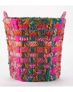 This basket was handcrafted by Indian artisans in the tradition of Rajaskthani folk art. Get it here: http://www.bhg.com/shop/world-market-large-round-chindi-basket-p503c6a8c82a7bb69c3e88df4.html