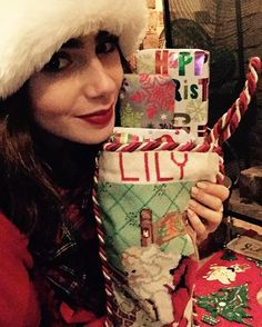 Lily Collins, Instagram. Looks like someone was more nice than naughty this year...