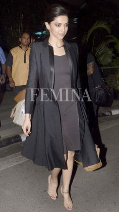 Deepika kept things fuss-free and super chic in an Armani LBD, a long coat and a sleek gold collar.