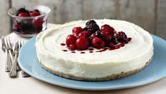 Lemon cheesecake - Ingredients - For the biscuit base: 10 digestive biscuits, 75g/3oz butter, melted,1 tbsp clear honey; - For the filling; 700g/1½ lb mascarpone cheese, 2 lemon, juice and zest, 200g/7oz caster sugar, plus more to taste, 4 tbsp icing sugar, mint, to garnish; For the sauce: 450g frozen summer fruits, defrosted, icing sugar, to taste.