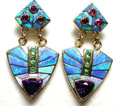 74 CTS 18 K OPAL INLAYED EARRINGS -DAVID FREELAND JNR[SAFE] 18 K Gold Weight of both earrings 74 cts app Size 40 x 24 mm app