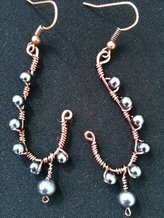 copper wire earrings. I'll have to try these, with denim colors stones.