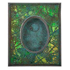 "TIFFANY STUDIOS; Grapevine picture frame, New York, 1900s; Patinated bronze, slag glass; Stamped TIFFANY STUDIOS NEW YORK 946; 10"" x 8"" Excellent original condition. Sale Price: $2,375 Estimate: $1,250 - $1,750"