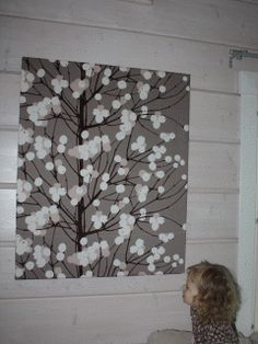 Marimekko Lumimarja wall art in a Finnish home.