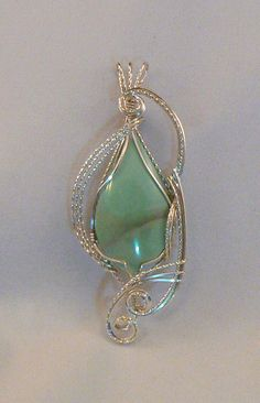 Stunning Varicite pendant wrapped in sterling silver wire. WOW, this is a fabulous gemstone. The color is awsome.