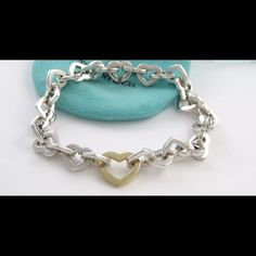 Tiffany & Co. RARE 18k gold heart link bracelet Excellent condition Tiffany & co. Bracelet with 18k gold heart in center of bracelet. Absolutely beautiful. One of my favorites. Was given to me by an old boyfriend. Hoping someone can give it the love it deserves. Tiffany & Co. Jewelry Bracelets