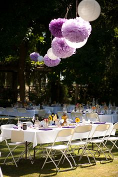 purple paper pompoms, white Japanese lanterns, colorful backyard shabby chic reception