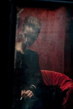 Katia Chausheva, the 58 year-old artist – based in the city of Plovdiv dips her lens beyond the patina of standardized beauty. She invites us to immerge ourselves in the deepest and most intimate dimension of women, which often results in obscurity, which Katia interprets with great technical control of the entire photographic process. A  glass, a hazy veil, a furtive look from the keyhole, a hallucination. The portraits of Chausheva are characterized by dark, opaque, dream like tones.
