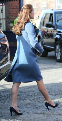 February 18, 2015 - Kate wore a rich blue Max Mara coat for today's engagements, a vibrant look on a brisk, sunny day. Her first stop: the Emma Bridgewater factory in Staffordshire.