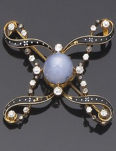 Victorian. A star sapphire, diamond and enamel brooch, circa 1890. Of quatrefoil design, the central cabochon star sapphire with black and white enamel scroll surround with old brilliant and rose-cut diamond detail.