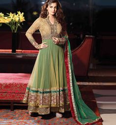 DIA MIRZA FLOOR LENGTH DESIGNER ANARKALI SUIT  Dress to impress with this Gorgeous Dia Mirza Green & Cream, Net & Santoon based floor length Anarkali Suit. Nice Designing is done on the Choli. Heavy Zari work, Resham embroidery and Heavy lace border is given on the dress to increase its look. A Santoon Bottom and Net Dupatta completes the look.