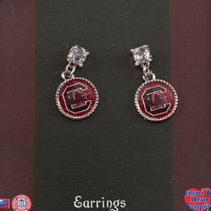 "NCAA South Carolina Gamecocks 1.25"" Earrings with a Round Logo Dangling from a Large Crystal Rhinestone Judson http://www.amazon.com/dp/B00JW4PNTI/ref=cm_sw_r_pi_dp_VPM4tb0SKSNC2"