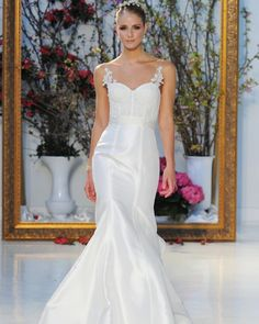 Anne Barge unveiled her latest wedding dresses during Bridal Fashion Week. Here, see the Spring 2017 collection.