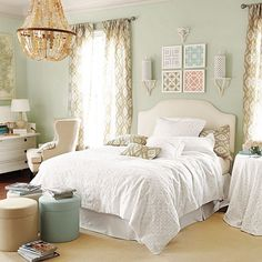 Suzanne Kasler eyelet bedding from Ballard Designs.  Love those pillows and curtains, too, and there is a coordinating rug.