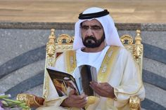 The Ruler of #Dubai peruses the #graduation #ceremony programme for the 39th batch of cadet officers.