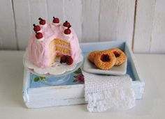 Miniature Cherry Cake And Cherry Jam Cookies On A Blue Shabby Chic Tray