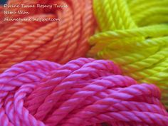 Vibrant colors of rosary twine in a mix of solid colors of Tangy Tangerine Orange, Perky Parakeet Yellow, & Mega Magenta Hot Pink!