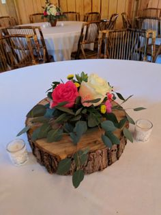 Small centerpiece to go on wood slice with greenery, roses and more
