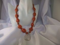Handmade Sterling silver, Acrylic pumpkin colored beads with Carnelian beads and silvertoned pendant