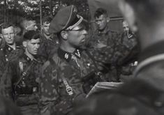 Waffen SS near Vitebsk during combat command guidance. Officer and men wear the camo standard issue smock.