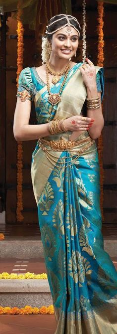 South Indian bride. Temple jewelry. Jhumkis.Teal Blue silk kanchipuram sari.Braid with fresh flowers. Tamil bride. Telugu bride. Kannada bride. Hindu bride. Malayalee bride.Kerala bride.South Indian wedding.