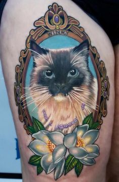 fuckyeahtattoos:My cat done in realism mixed with neotraditional.Done by Jeremy Brown of Armored Ink. Lake Elsinore, CA, US.