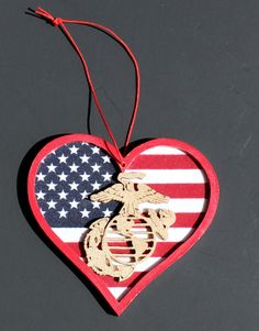 """Official Hobbyist of the USMC License 11603 USMC Wood Heart Shaped Ornament with EGA """"Marine in my Heart"""". Measures approx inches x Has US flag background and a detailed hand cut EGA made of Marine Mom, Marine Corps, Military Crafts, Military Mom, Marines Logo, Christmas Ornaments, Christmas Ideas, Christmas Crafts, Christmas Decorations"""