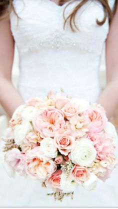 Blush wedding bouquet so pretty but deffinintly with whit and pink tiger Lilly's with roses