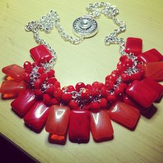 Red and orange glass necklace on silver chain with crystal clasp