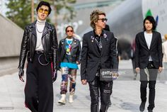 Guests wearing black leather jackets and pants and blazer attend day 5 of HERA Seoul Fashion Week on October 21, 2016 in Seoul, South Korea.