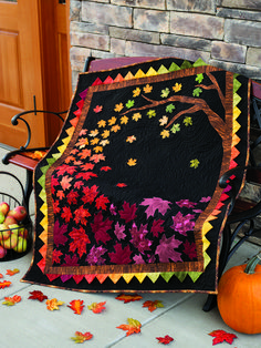 Seasonal Quilt Patterns - The Autumn Allure quilt is the perfect couch throw for welcoming in the fall season. Hang on your wall and watch the colors fill your whole house! Would make a lovely gift! Pattern includes full size templates. Finished Size: 40 1/2' x 51 1/2'