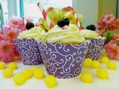 Lemon Blueberry Cupcakes wrapped in Purple Cupcake Wrappers for the Cupcake Couture Blog Party. #cupcakecouture