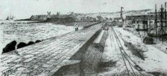 """1884,  Porto de Ponta Delgada, Ilha de São Miguel    """"Panorâmica do Porto de Ponta Delgada, vendo-se em fundo à esquerda, ainda bem definidas, a ponta """"dos algares"""" e a ponta """"delgada e rasa"""", ou """"de Santa Clara""""."""