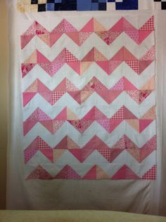 Chevron Baby Quilt backed w Mimkie plus a tutorial. Materials required:  50 pink charm squares...