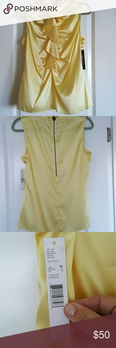 Silk?Gorgeous Yellow Blouse 95% Silk 5% Spandex makes this color of the year, yellow, beautiful yet comfortable. Size Medium. I was a 36d, and this fit me. Full back size, with hi end detailing. Shown under a blue blazer for color contrast. Such a find, love this blouse. ANTONIO MELANI Tops Blouses