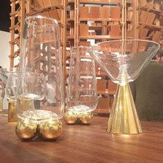 Vanessa Mitrani's sculptural glassware set comprises four tumblers, four highballs and four martini glasses, all set onto bronze bases