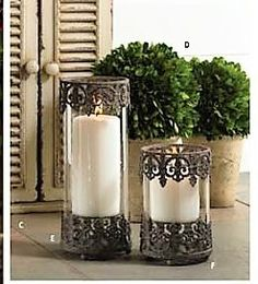 """Glass Candle Holder with Black Metal Base and Frame. These are stunning and add an air of sophistication and ambience wherever they are placed. Lovely alone or paired with 12178A 10.5""""H x 4""""Dia."""
