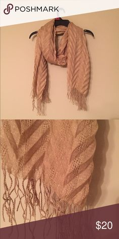 ⚡CLOSET SALE⚡️Gold Scarf This scarf has only been used a handful of times. It has a crimped like texture and is extremely thick and warm. The color is a gorgeous gold with some sparkles. It is a bigger scarf, but not the size of a blanket scarf.🔥Closet Sale🔥 Buy 2 items and Get the 3rd FREE- if you are interested check out the sale listing Accessories Scarves & Wraps