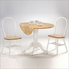 International Concepts Dining Essentials White & Natural 42 in. Dual Drop Leaf Dining Table w/ Two Windsor Chairs White/Natural Table, Windsor Dining Chairs, Dining Table In Kitchen, Solid Wood Dining Set, Dining Table Chairs, Round Wood Table, Home Decor, Pedestal Dining Table, Table And Chair Sets