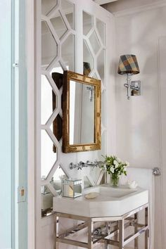 Mirrored trellis wall behind hanging mirror