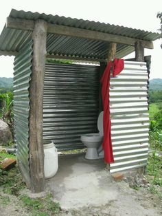 Outhouse -- new pedestal, cement floor, timber frame, corrugated iron or zincalume cladding, and a curtain for privacy!